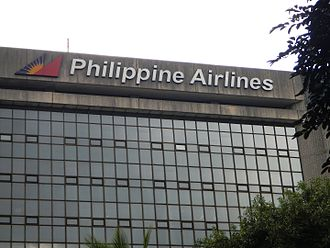 Philippine Airlines - The Philippine Airlines logo shown on the PNB Financial Headquarters from Roxas Boulevard