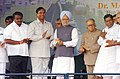 Manmohan Singh, lays foundation stone of ten-laning of 9.89 Kms long mixed corridor to Electronic City in Bangalore. The Governor of Karnataka, Shri T. N. Chaturvedi, the Union Minister for Shipping.jpg