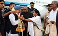 Manmohan Singh being received by the Chief Minister of West Bengal, Kumari Mamata Banerjee, on his arrival, at Netaji Subhash Chandra Bose International Airport, Kolkata, West Bengal. The Governor of West Bengal.jpg