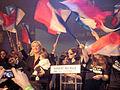 Marine Le Pen, bébé, drapeaux, banquet des Mille3louis maitrier.jpg