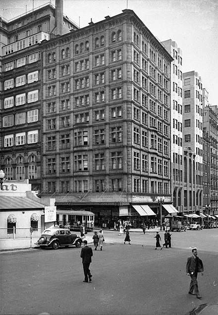 Commercial Travellers Club Building, demolished in the 1970s during a contemporary boom, was one of Sydney's tallest buildings until height restrictions were lifted in the 1960s. Martin Place and Castlereagh Street; Hotel Australia, Sydney, ca. 1935 - photographers Hall & Co. (7731559286).jpg