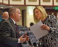 Matt Willhite and Heather Fitzenhagen confer on the House floor.jpg
