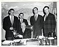 Mayor John F. Collins cogratulates the English High Swimming Team on winning the State Title. (l-r) James Heelen, Co-Captain; Robert C. Carrol, Assistant Coach; Ed Doherty, Co-Captain; Daniel F. Tarpey, Head Coach (12774656674).jpg