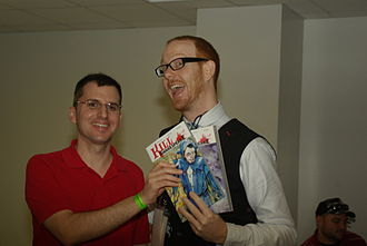 Kill Shakespeare - McCreery (right) with a reader at the Miami Book Fair International, 2011