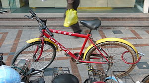 Freight bicycle - A McDelivery bicycle in Shanghai, China. The containers and panniers that carry food have been removed for loading.