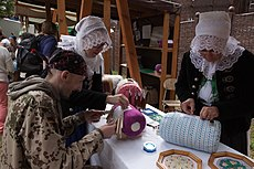 Member of the Carpathian Ethnography project team during lesson of bobbin laces making at the Myjava-Festival.jpg