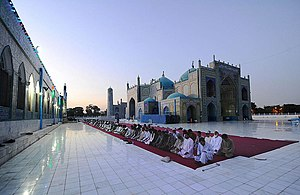 Islam in Afghanistan - Men praying at the Blue Mosque (or Shrine of Ali) in the northern Afghan city of Mazar-i-Sharif.
