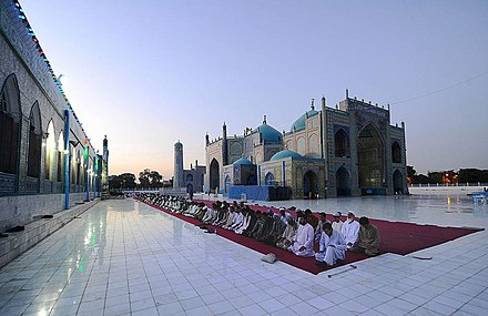 "Men praying during Ramadan at the Shrine of Ali or ""Blue Mosque"" in Mazar-i-Sharif, Afghanistan Men praying in Afghanistan.jpg"