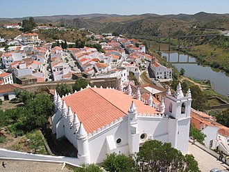 Mértola - View of Mértola, over the Guadiana River. The main church (igreja matriz), originally a mosque, is in the foreground.