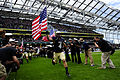 Midshipman Bo Snelson with flag.jpg