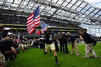 2012 Kraft Fight Hunger Bowl - Image: Midshipman Bo Snelson with flag