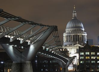 St Paul's Cathedral - St Paul's illuminated, with the Millennium Bridge in the foreground