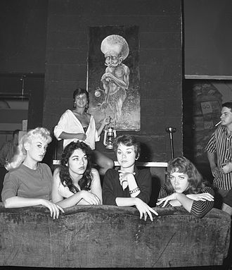 "Beatnik - The news photo caption for this 1959 event in Venice, California read: ""Beatnik Beauties: Posing before a sample of beatnik art are contestants for the title of Miss Beatnik of 1959, which will be conferred Sept. 12 under sponsorship of the Venice Arts Committee. From left are Michi Monteef, Sammy McCord, Patti McCrory, Shaunna Lea and, in rear, Jan Vandaveer."""