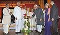 Mohd. Hamid Ansari lighting the lamp at the Valedictory Function of the centenary celebrations of the Catholic Association of South Kanara, in Mangalore. The Governor of Karnataka.jpg