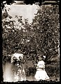 Mother and daughter in apple grove, c1913 (4272979429).jpg