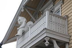 Mustosen talo Angel on the balcony.JPG