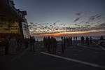 NASA, contractor and U.S. Navy personnel are on the deck of the USS San Diego as the sun sets on the fourth day of Underway Recovery Test 5 (30697502285).jpg