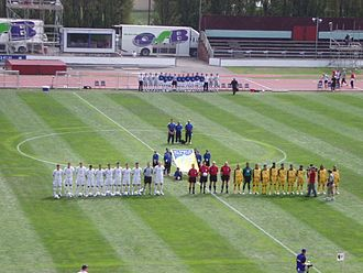 Malaysia national football team - The Malaysian team (yellow) against New Zealand (white) during a friendly match in Queen Elizabeth II Park, Christchurch, New Zealand on 19 February 2006.