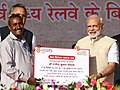 Narendra Modi handing over the certificates etc. to select beneficiaries of various welfare schemes of the Union and State Governments (1).JPG