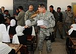 National Guardsmen distribute school supplies DVIDS342607.jpg