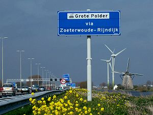 "A4 motorway (Netherlands) - Dutch scenery along A4 with windmill ""Zelden van Passe"" near Zoeterwoude."