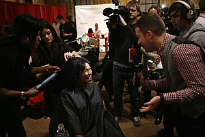 Stylists do Nia Long's hair backstage at The H...