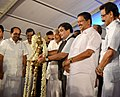 Nitin Gadkari lighting the traditional lamp at the ground breaking ceremony of the Vizhinjam International Deepwater Multipurpose Seaport project, at Vizhinjam, in Thiruvananthapuram, Kerala. The Chief Minister of Kerala.jpg