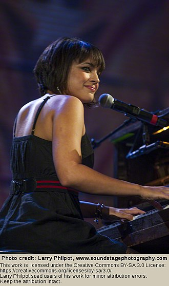 Norah Jones - Jones performs at Farm Aid on October 2, 2010