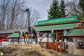 Nyíregyháza Zoo - A giraffe statue stands between the entrance and the main road