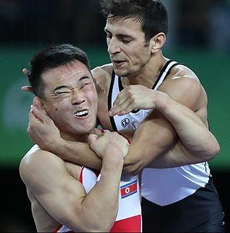Yun Won-chol - Yun Won-chol (left) vs Haithem Mahmoud, Rio 2016