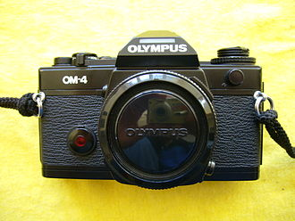 Olympus OM-4 - Frontal view of an OM-4 camera body, without lens attached