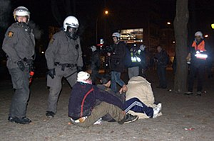2008–09 Oslo riots - Riot police covering arrested rioters.