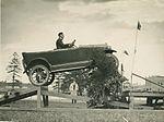 "Overland car jumping a ""fallen bridge"" in a promotional stunt, 1920 - 1929 (4361746102).jpg"