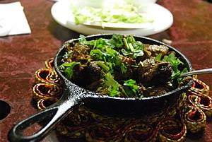 Pakistani cuisine - Lahori Beef Karahi, usually served with freshly made tandoori naan