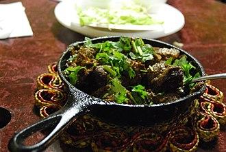 Pakistani cuisine - Lahori Beef Karahi, usually served with freshly made tandoori naan
