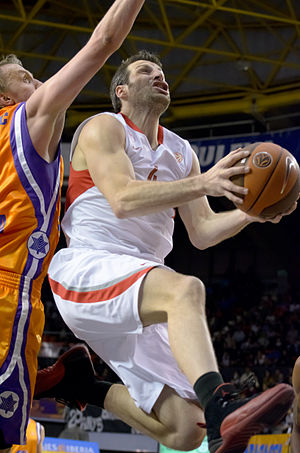 EuroLeague Basketball Legend Award - Theo Papaloukas, in white, with the ball, as an Olympiacos player, 2011.