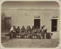 Pastimes of Central Asians. A Group of Female Performers, Possibly Uzbek, Kneeling on a Rug WDL10831.png