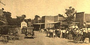 Pea Ridge, Arkansas - Downtown Pea Ridge looking east on Pickens Road in 1914. The white structure at the end of the street was a hotel operated by the Martin family, which burned down around 1920.