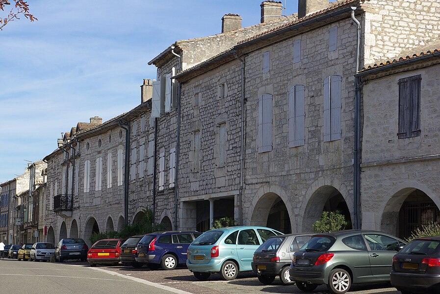 East side of the place Gambetta in Castelnau-Montratier, (Lot, France).