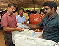 Polling officials collecting the Electronic Voting Machines (EVM's) and other necessary inputs required for the General Elections-2014, at the distribution centre, at Thycaud, Thiruvananthapuram, Kerala on April 09, 2014.jpg