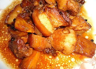 Philippine adobo - Pork adobo, with vinegar, soy sauce, garlic, onions, black pepper, and pineapples
