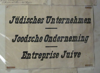 The Holocaust in Belgium - Trilingual (German-Dutch-French) signs used to mark Jewish-owned shops and businesses in Belgium from October 1940