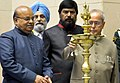 """Pranab Mukherjee lighting the lamp at the presentation of the """"National Awards for the Empowerment of Persons with Disabilities (Divyangjan), 2016"""", on the occasion of the """"International Day of Disabled Persons"""".jpg"""