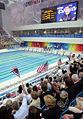 President George W. Bush waves American flag Phelps presented medal.jpg