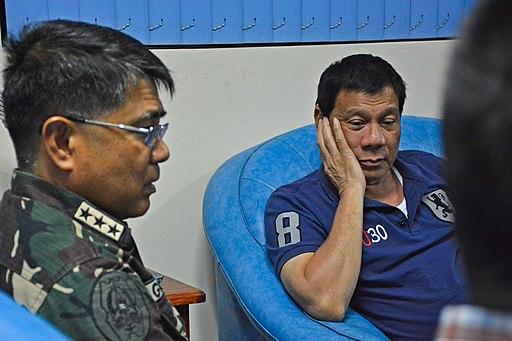 President Rodrigo Duterte listens to the report of Lt. Gen. Rey Leonardo Guerrero