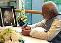 Prime Minister Narendra Modi signs the condolence book at the funeral of Lee Kuan Yew.jpg