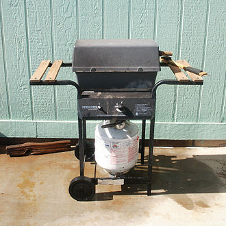 Barbecue grill - A single-burner propane gas grill that conforms to the cart grill design common among gas grills.