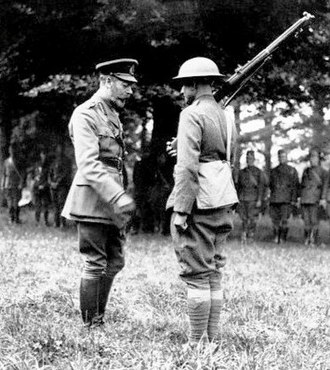 Doughboy - Pvt. Harry Shelly, Co A, US 132nd Infantry, 33rd Division (right) receives the British Distinguished Conduct Medal from King George V (July 4, 1918)