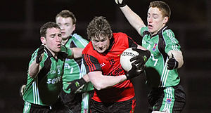 Down GAA - Down (red) in action against Queens University Belfast in the 2009 Dr. McKenna Cup