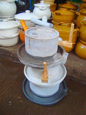 Quern-stone - A stack of quern-stones for sale in a market in Haikou, Hainan, China. These quern-stones are only about 30 cm wide.